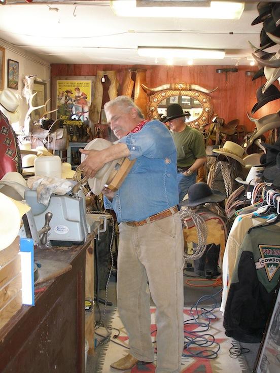 Randy Rodriquez, owner Rio Bravo Trading Company blocking Thom Valenza`s hat<br>www.riobravotradingcompany.com