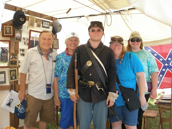 Paul Johnson Jr. and his family from Smyrna DE <br>Paul is a university student and reenactor who was participating in the 150th.  He stopped by our tent with his family and was fitted with some new specs.