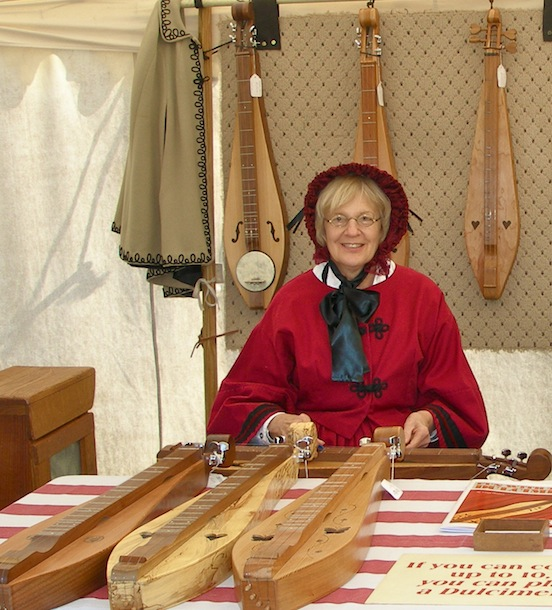 Jackie Gardner of  Gardner`s Dulcimer www.gardnersdulcimer.com<br>Jackie and her husband Don are the proprietors of Garden`s Dulcimers. They had a sutlers tent during the 149th Cedar Creek Battle Reenactment.  Jackie showed us how to play our new dulcimer. They are all handmade by them. Visit their  www.gardnersdulcimer.com for more information.
