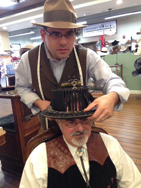 Watson`s Hat Shop-  Cave Creek, Arizona<br>Thomas is gettin fitted by Eric Watson in his shop- Watson`s Hat Shop with a antique original hat measuring tool