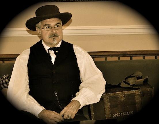 Thom Valenza , portraying spectacle peddler, George Washington Hotel, Winchester, Va., 2012<br>