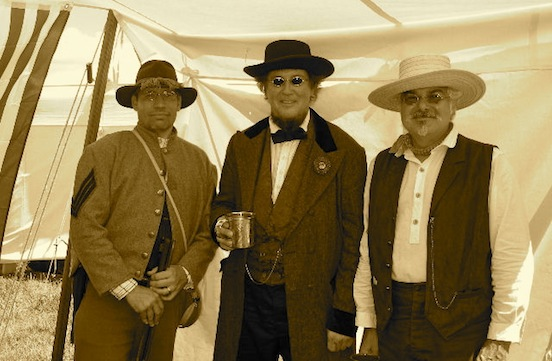 Confederate President Jefferson Davis, his body guard, and Tom. <br>President Davis,AKA David Walker from Ohio under the Historic EyeWear Company sulter tent just fitted with his new specs!