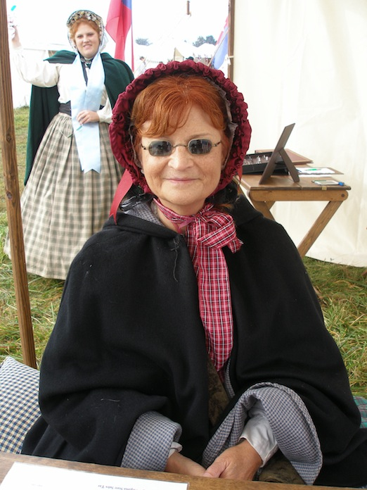 Amanda Morgante looks over while Emily Morgante is fitted for specs<br>At the Cedar Creek Battle Reenactment
